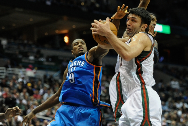 Nov 16, 2013; Milwaukee, WI, USA;  Milwaukee Bucks center Zaza Pachulia (27) grabs a rebound against Oklahoma City Thunder forward Serge Ibaka (9) in the 4th quarter at BMO Harris Bradley Center. Mandatory Credit: Benny Sieu-USA TODAY Sports