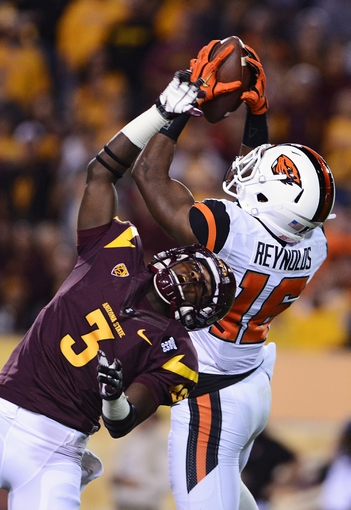 Nov 16, 2013; Tempe, AZ, USA; Oregon State Beavers cornerback Larry Scott (15) intercepts a pass over Arizona State Sun Devils wide receiver Richard Smith (3) in the first half of the game at Sun Devil Stadium. Mandatory Credit: Jennifer Stewart-USA TODAY Sports