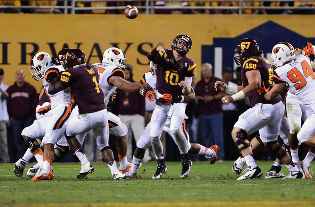 Nov 16, 2013; Tempe, AZ, USA; Arizona State Sun Devils quarterback Taylor Kelly (10) makes a pass in the first half of the game against Oregon State Beavers defense at Sun Devil Stadium. Mandatory Credit: Jennifer Stewart-USA TODAY Sports