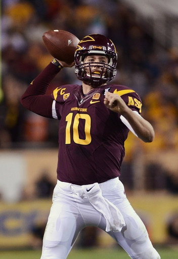 Nov 16, 2013; Tempe, AZ, USA; Arizona State Sun Devils quarterback Taylor Kelly (10) makes a pass against the Oregon State Beavers in the first half at Sun Devil Stadium. Mandatory Credit: Jennifer Stewart-USA TODAY Sports