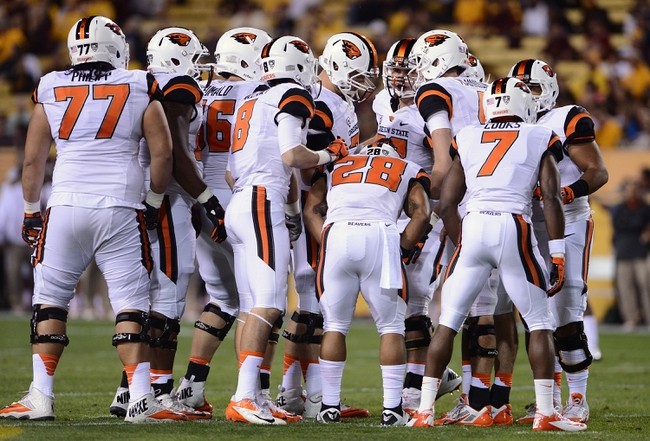 Nov 16, 2013; Tempe, AZ, USA; Oregon State Beavers quarterback Sean Mannion (4) talks with his team in a huddle in the first half of the game against Arizona State Sun Devils at Sun Devil Stadium. Mandatory Credit: Jennifer Stewart-USA TODAY Sports