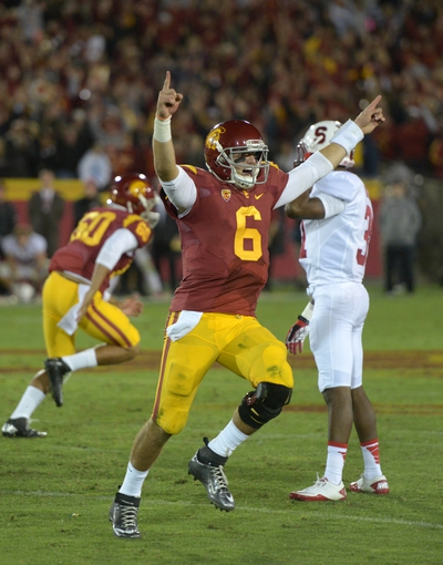 Nov 16, 2013; Los Angeles, CA, USA; Southern California Trojans quarterback Cody Kessler (6) celebrates after a 47-yard field goal by Andre Heidari (not pictured) with 19 seconds left against the Stanford Cardinal at Los Angeles Memorial Coliseum. USC defeated Stanford 20-17. Mandatory Credit: Kirby Lee-USA TODAY Sports