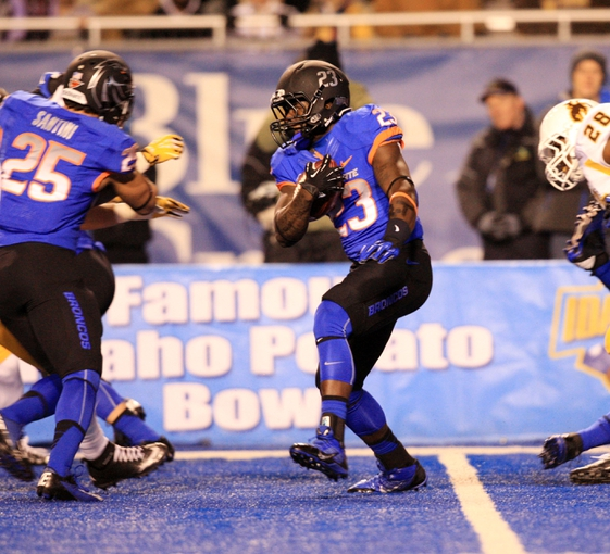 Nov 16, 2013; Boise, ID, USA; Boise State Broncos running back Derrick Thomas (23) runs a kick off back during the first half against the Wyoming Cowboys at Bronco Stadium. Mandatory Credit: Brian Losness-USA TODAY Sports