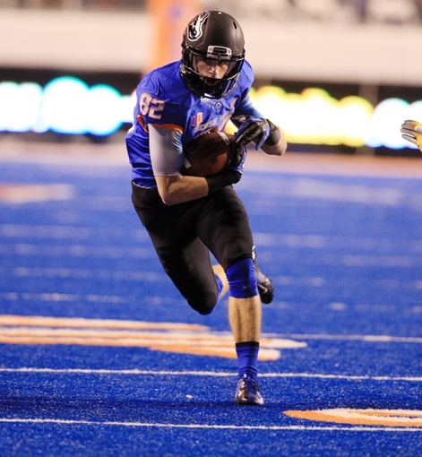 Nov 16, 2013; Boise, ID, USA; Boise State Broncos wide receiver Thomas Sperbeck (82) runs for a first down on screen pass during the first half against the Wyoming Cowboys at Bronco Stadium. Mandatory Credit: Brian Losness-USA TODAY Sports