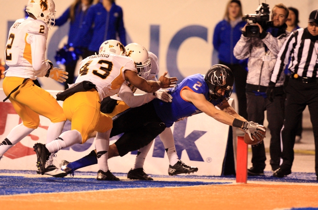 Nov 16, 2013; Boise, ID, USA; Boise State Broncos wide receiver Matt Miller (2) stretches out for a touchdown as Wyoming Cowboys linebacker Devyn Harris (43) and safety Marqueston Huff (2) attempts to stop him during the first half  at Bronco Stadium. Mandatory Credit: Brian Losness-USA TODAY Sports