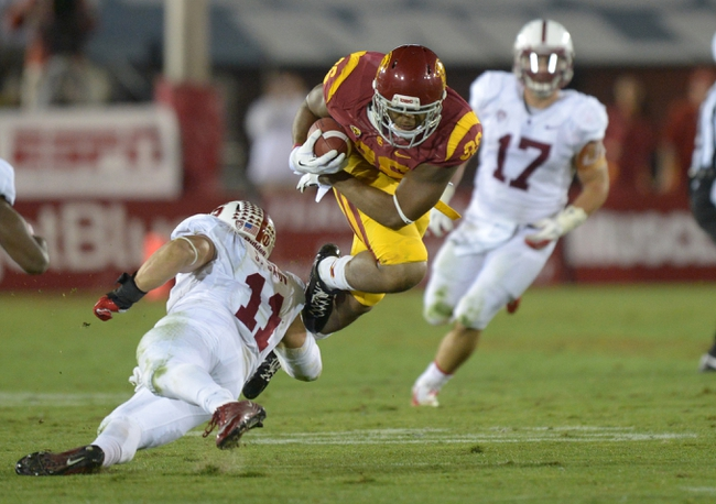 Nov 16, 2013; Los Angeles, CA, USA; Southern California Trojans tight end Xavier Grimble (86) is tackled by Stanford Cardinal linebacker A.J. Tarpley (17) at Los Angeles Memorial Coliseum. USC defeated Stanford 20-17. Mandatory Credit: Kirby Lee-USA TODAY Sports