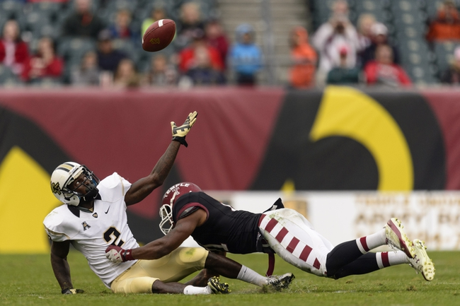 Nov 16, 2013; Philadelphia, PA, USA; UCF Knights wide receiver Jeff Godfrey (2) is unable to make the catch as he is tackled by Temple Owls defensive back Abdul Smith (21) during the fourth quarter at Lincoln Financial Field. UCF defeated Temple 39-36. Mandatory Credit: Howard Smith-USA TODAY Sports