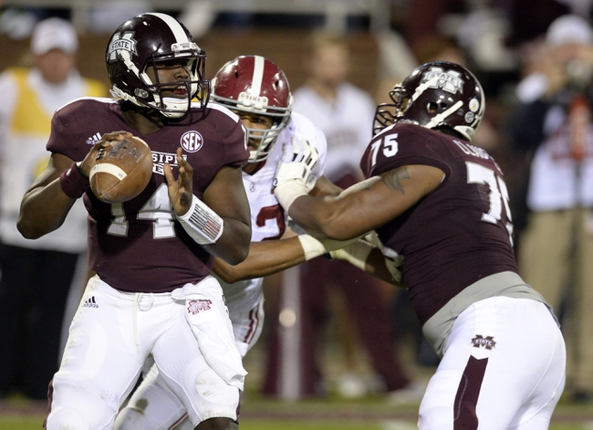 Nov 16, 2013; Starkville, MS, USA;  Mississippi State Bulldogs quarterback Damian Williams (14) looks to pass against the Alabama Crimson Tide during the fourth quarter at Davis Wade Stadium. Alabama defeated Mississippi State 20-7. Mandatory Credit: John David Mercer-USA TODAY Sports