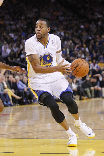 Nov 16, 2013; Oakland, CA, USA; Golden State Warriors forward Andre Iguodala (9) looks to pass the ball against the Utah Jazz in the second quarter at Oracle Arena. Mandatory Credit: Cary Edmondson-USA TODAY Sports