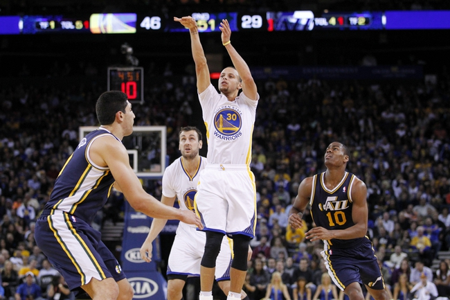 Nov 16, 2013; Oakland, CA, USA; Golden State Warriors guard Stephen Curry (30) attempts a shot against the Utah Jazz in the second quarter at Oracle Arena. Mandatory Credit: Cary Edmondson-USA TODAY Sports