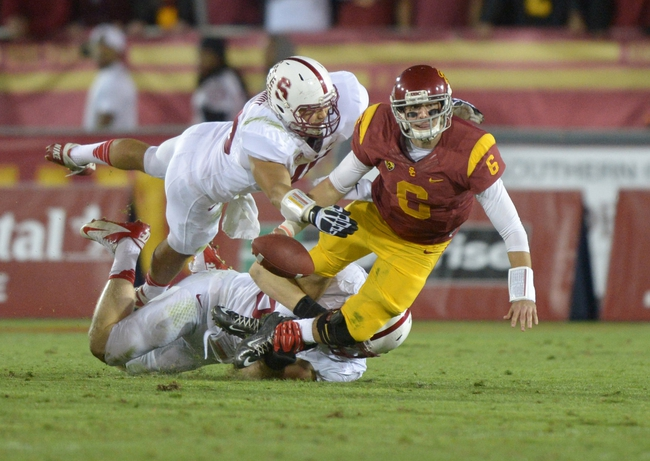 Nov 16, 2013; Los Angeles, CA, USA; Stanford Cardinal linebackers Joe Hemschool (40) and Trent Murphy (93) force a fumble by Southern California Trojans quarterback Cody Kessler (6) at the Los Angeles Memorial Coliseum. USC defeated Stanford 20-17. Mandatory Credit: Kirby Lee-USA TODAY Sports