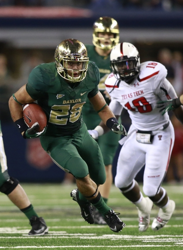 Nov 16, 2013; Arlington, TX, USA; Baylor Bears running back Devin Chafin (28) runs against the Texas Tech Red Raiders in the fourth quarter of the game at AT&T Stadium.  Baylor beat Texas Tech 63-34. Mandatory Credit: Tim Heitman-USA TODAY Sports