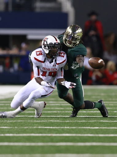 Nov 16, 2013; Arlington, TX, USA; Baylor Bears cornerback K.J. Morton (8) knocks the ball away from Texas Tech Red Raiders wide receiver Derreck Edwards (19) in the fourth quarter of the game at AT&T Stadium.  Baylor beat Texas Tech 63-34. Mandatory Credit: Tim Heitman-USA TODAY Sports