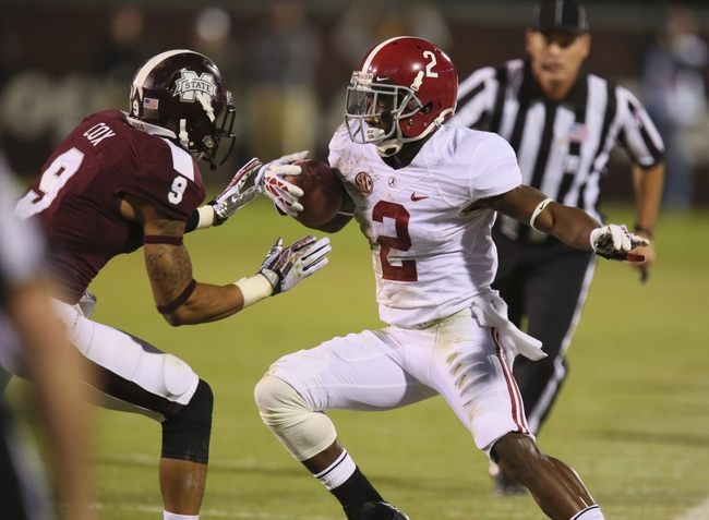 Nov 16, 2013; Starkville, MS, USA; Alabama Crimson Tide wide receiver DeAndrew White (2) advances the ball against Mississippi State Bulldogs defensive back Justin Cox (9) during the game at Davis Wade Stadium. Alabama Crimson Tide defeat the Mississippi State Bulldogs with a score of 20-7.  Mandatory Credit: Spruce Derden-USA TODAY Sports