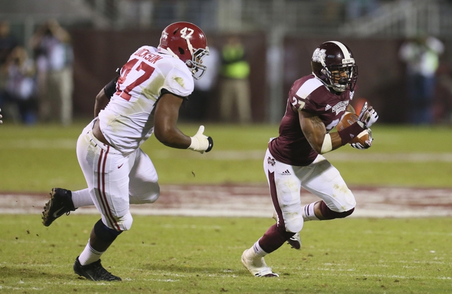 Nov 16, 2013; Starkville, MS, USA; Mississippi State Bulldogs running back LaDarius Perkins (27) advances the ball and is chased by Alabama Crimson Tide linebacker Xzavier Dickson (47) during the game at Davis Wade Stadium. Alabama Crimson Tide defeat the Mississippi State Bulldogs with a score of 20-7.  Mandatory Credit: Spruce Derden-USA TODAY Sports