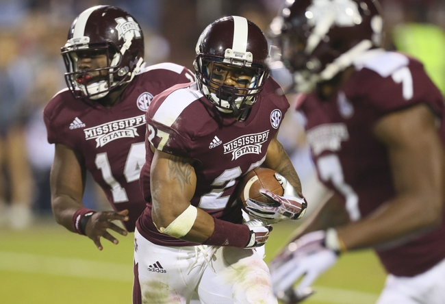 Nov 16, 2013; Starkville, MS, USA; Mississippi State Bulldogs running back LaDarius Perkins (27) advances the ball during the game against the Alabama Crimson Tide at Davis Wade Stadium. Alabama Crimson Tide defeat the Mississippi State Bulldogs with a score of 20-7.  Mandatory Credit: Spruce Derden-USA TODAY Sports
