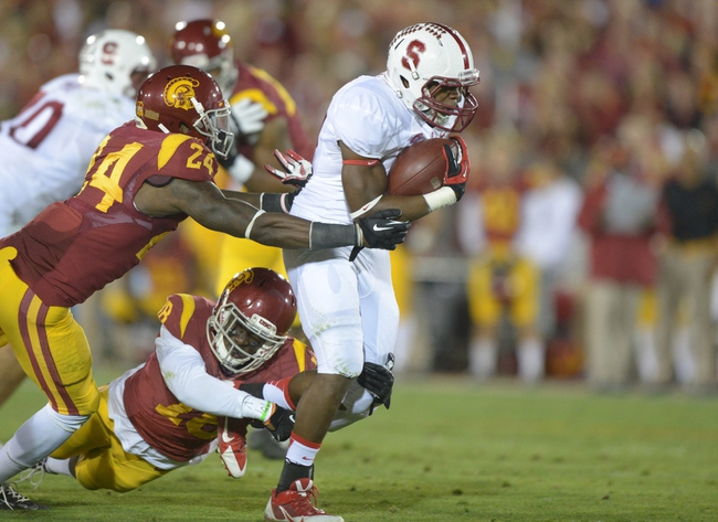 Nov 16, 2013; Los Angeles, CA, USA; Southern California Trojans safety Demetrius Wright (24) and linebacker Dion Bailey (18) tackle Stanford Cardinal running back Anthony Wilkerson (32) at Los Angeles Memorial Coliseum. USC defeated Stanford 20-17. Mandatory Credit: Kirby Lee-USA TODAY Sports