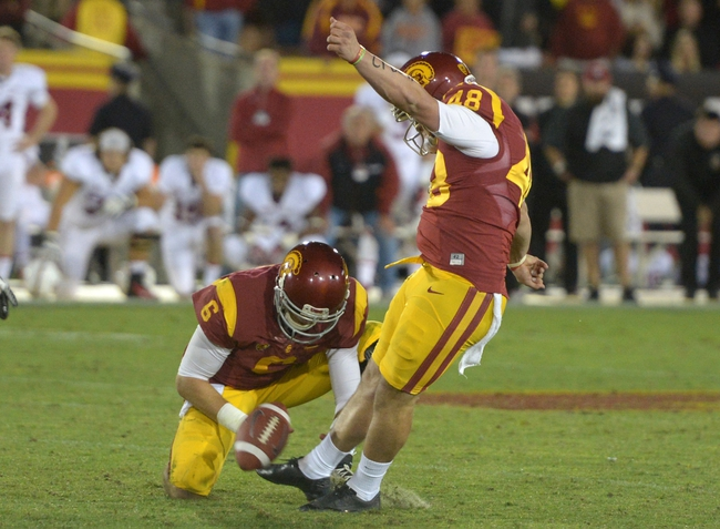 Nov 16, 2013; Los Angeles, CA, USA; Southern California Trojans kicker Andre Heidari (48) kicks a 47-yard field goal out of the hold of Cody Kessler (6) with 19 seconds left against the Stanford Cardinal at Los Angeles Memorial Coliseum. USC defeated Stanford 20-17. Mandatory Credit: Kirby Lee-USA TODAY Sports