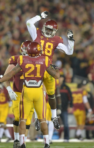 Nov 16, 2013; Los Angeles, CA, USA; Southern California Trojans linebacker Dion Bailey (18) celebrates with safety Su'a Cravens (21) after intercepting a pass in the fourth quarter against the Stanford Cardinal at Los Angeles Memorial Coliseum. USC defeated Stanford 20-17. Mandatory Credit: Kirby Lee-USA TODAY Sports