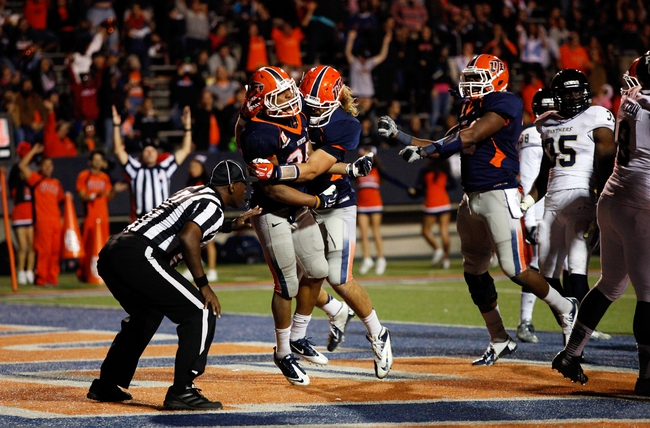 Nov 16, 2013; El Paso, TX, USA; UTEP Miners running back Nathan Jeffery (25) celebrates with teammates after running in for a touchdown against the FIU Golden Panthers at Sun Bowl Stadium. Mandatory Credit: Ivan Pierre Aguirre-USA TODAY Sports