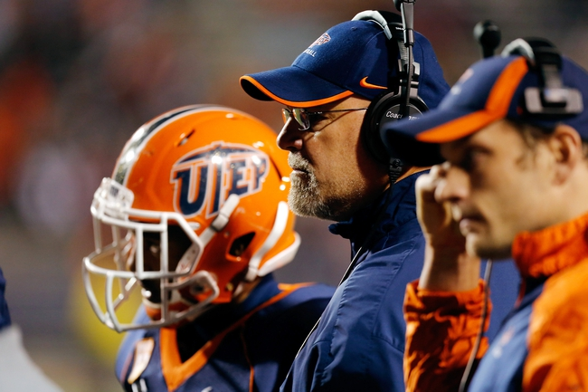 Nov 16, 2013; El Paso, TX, USA; UTEP Miners head coach Sean Kugler speaks to his team during a timeout against the FIU Golden Panthers at Sun Bowl Stadium. Mandatory Credit: Ivan Pierre Aguirre-USA TODAY Sports