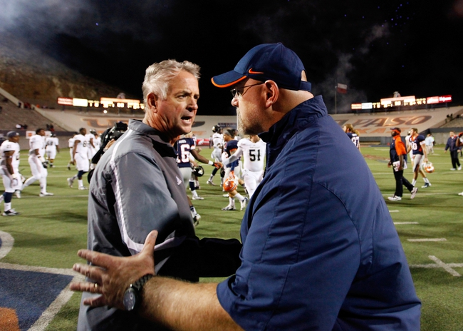 Nov 16, 2013; El Paso, TX, USA; FIU head coach Ron Turner, left, and UTEP head coach Sean Kugler shake hands after the Miners defeated the Golden Panthers at Sun Bowl Stadium. Mandatory Credit: Ivan Pierre Aguirre-USA TODAY Sports