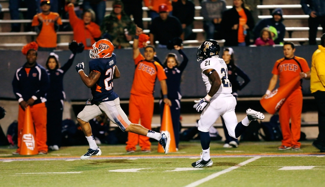 Nov 16, 2013; El Paso, TX, USA; UTEP Miners running back Nathan Jeffery (25) runs in for a touchdown against the FIU Golden Panthers at Sun Bowl Stadium. Mandatory Credit: Ivan Pierre Aguirre-USA TODAY Sports