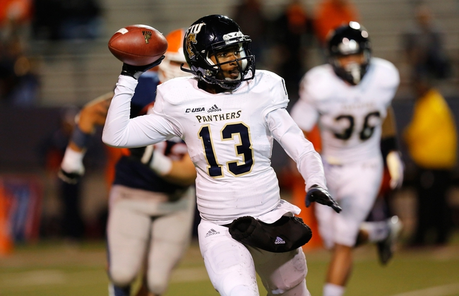 Nov 16, 2013; El Paso, TX, USA;  FIU Golden Panthers quarterback E.J. Hilliard (13) drops back to pass the ball against the UTEP Miners at Sun Bowl Stadium. Mandatory Credit: Ivan Pierre Aguirre-USA TODAY Sports