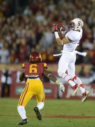 Nov 16, 2013; Los Angeles, CA, USA; Stanford Cardinal receiver Michael Rector (3) catches a pass as Southern California Trojans cornerback Josh Shaw (6) defends at Los Angeles Memorial Coliseum. USC defeated Stanford 20-17. Mandatory Credit: Kirby Lee-USA TODAY Sports
