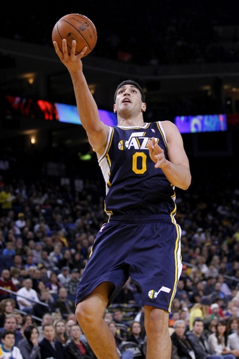 Nov 16, 2013; Oakland, CA, USA; Utah Jazz center Enes Kanter (0) attempts a shot against the Golden State Warriors in the third quarter at Oracle Arena. The Warriors defeated the Jazz 102-88. Mandatory Credit: Cary Edmondson-USA TODAY Sports