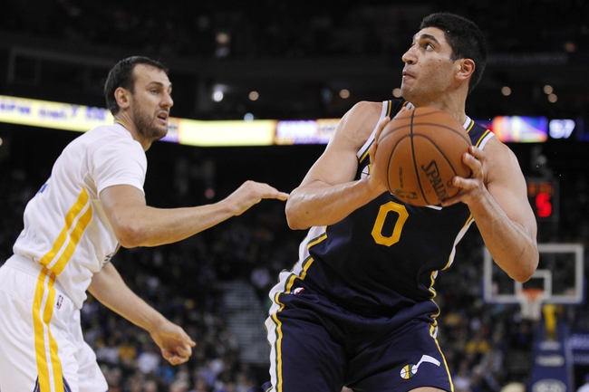 Nov 16, 2013; Oakland, CA, USA; Utah Jazz center Enes Kanter (0) looks to attempt a shot next to Golden State Warriors center Andrew Bogut (12) in the third quarter at Oracle Arena. The Warriors defeated the Jazz 102-88. Mandatory Credit: Cary Edmondson-USA TODAY Sports