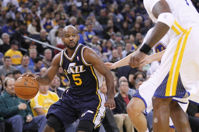 Nov 16, 2013; Oakland, CA, USA; Utah Jazz guard John Lucas III (5) dribbles the ball against the Golden State Warriors in the third quarter at Oracle Arena. The Warriors defeated the Jazz 102-88. Mandatory Credit: Cary Edmondson-USA TODAY Sports