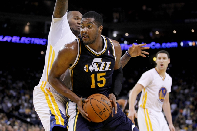 Nov 16, 2013; Oakland, CA, USA; Utah Jazz forward Derrick Favors (15) looks for room to shoot against the Golden State Warriors in the fourth quarter at Oracle Arena. The Warriors defeated the Jazz 102-88. Mandatory Credit: Cary Edmondson-USA TODAY Sports