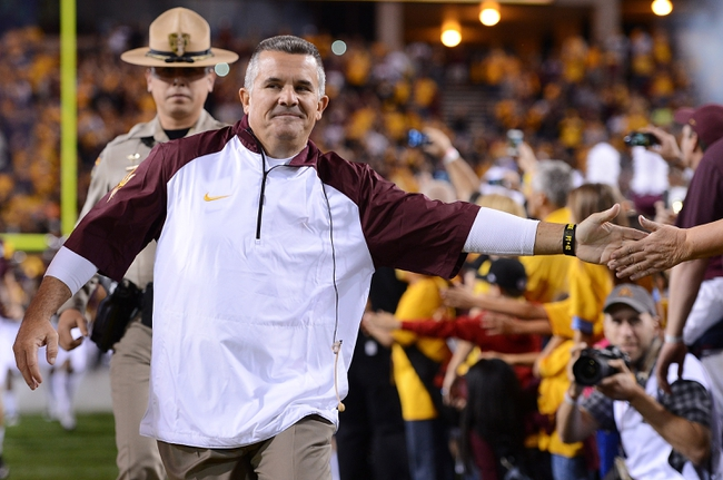 Nov 16, 2013; Tempe, AZ, USA; Arizona State Sun Devils head coach Todd Graham runs onto the field prior to the game against the Oregon State Beavers at Sun Devil Stadium. The Devils defeated the Beavers 30-17. Mandatory Credit: Jennifer Stewart-USA TODAY Sports