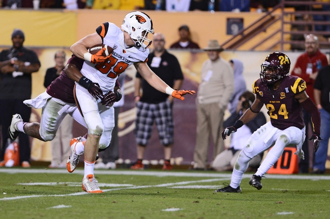 Nov 16, 2013; Tempe, AZ, USA; Oregon State Beavers tight end Connor Hamlett (89) runs the ball against Arizona State Sun Devils linebacker Chris Young (5) and cornerback Osahon Irabor (24) in the second half at Sun Devil Stadium. The Devils defeated the Beavers 30-17. Mandatory Credit: Jennifer Stewart-USA TODAY Sports