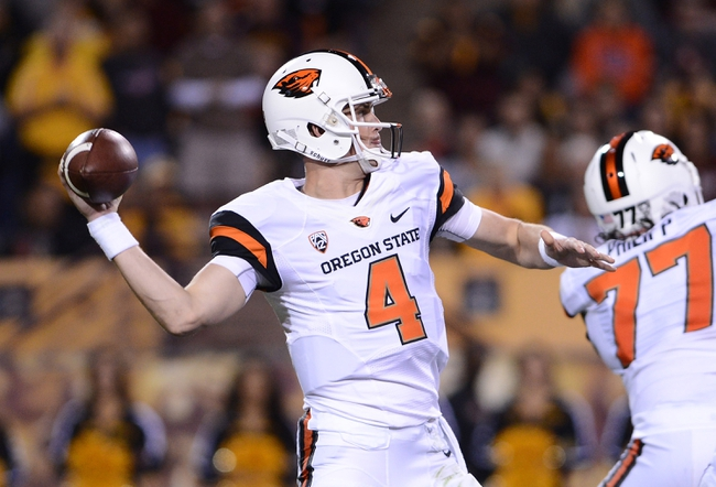 Nov 16, 2013; Tempe, AZ, USA; Oregon State Beavers quarterback Sean Mannion (4) makes a pass during the second half of the game against Arizona State Sun Devils at Sun Devil Stadium. The Devils defeated the Beavers 30-17. Mandatory Credit: Jennifer Stewart-USA TODAY Sports