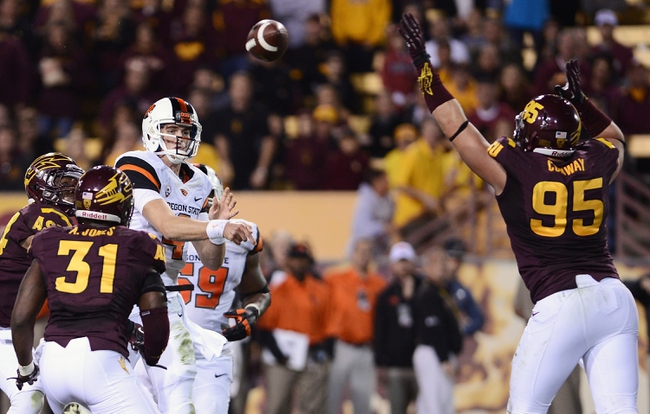 Nov 16, 2013; Tempe, AZ, USA; Oregon State Beavers quarterback Sean Mannion (4) makes a pass against Arizona State Sun Devils defensive end Gannon Conway (95) in the second half at Sun Devil Stadium. The Devils defeated the Beavers 30-17. Mandatory Credit: Jennifer Stewart-USA TODAY Sports