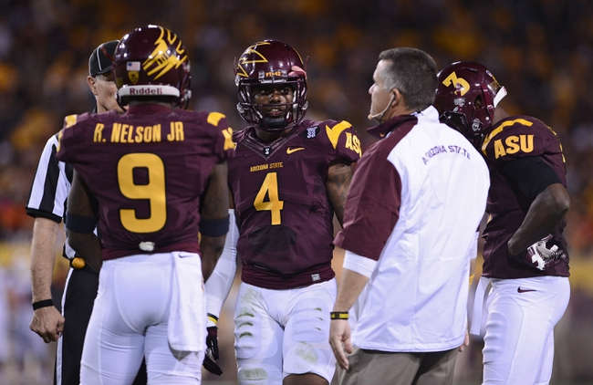 Nov 16, 2013; Tempe, AZ, USA; Arizona State Sun Devils head coach Todd Graham talks with defensive back Robert Nelson (9) and safety Alden Darby (4) in the game against Oregon State Beavers at Sun Devil Stadium. The Devils defeated the Beavers 30-17. Mandatory Credit: Jennifer Stewart-USA TODAY Sports