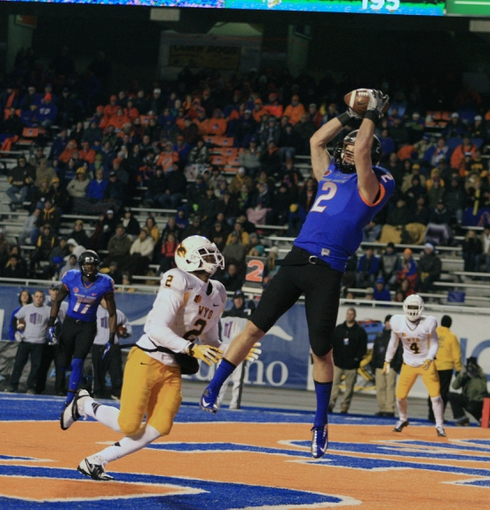 Nov 16, 2013; Boise, ID, USA; Boise State Broncos wide receiver Matt Miller (2, right) catches a touchdown over Wyoming Cowboys safety Marqueston Huff (2, left) during the second half at Bronco Stadium. Boise State defeated Wyoming 48-7. Mandatory Credit: Brian Losness-USA TODAY Sports