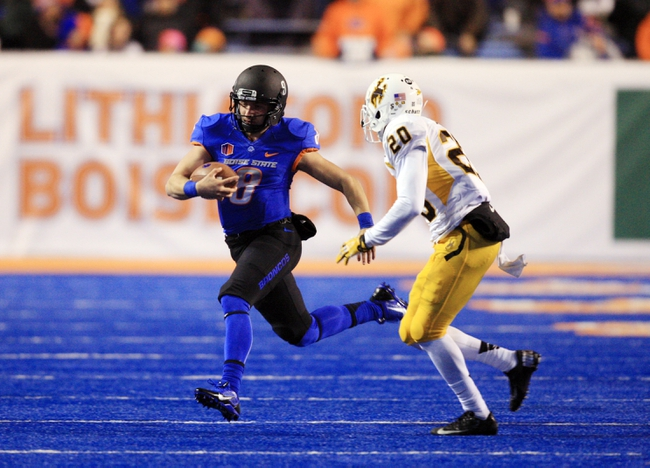 Nov 16, 2013; Boise, ID, USA; Boise State Broncos quarterback Nick Patti (8) scrambles for a first down with Wyoming Cowboys cornerback Blair Burns (20) in pursuit during the second half at Bronco Stadium. Boise State defeated Wyoming 48-7. Mandatory Credit: Brian Losness-USA TODAY Sports