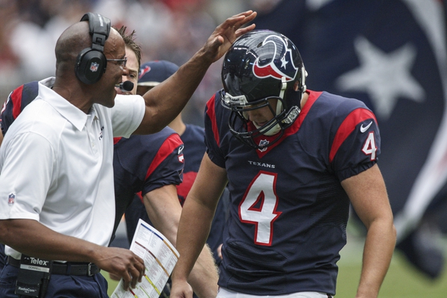 Nov 17, 2013; Houston, TX, USA; Houston Texans kicker Randy Bullock (4) is congratulated by a coach after making a field goal during the second quarter against the Oakland Raiders at Reliant Stadium. Mandatory Credit: Troy Taormina-USA TODAY Sports