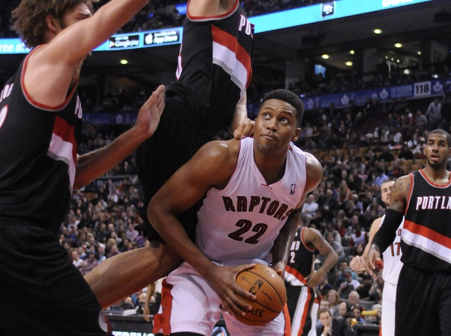 Nov 17, 2013; Toronto, Ontario, CAN; Toronto Raptors small forward Rudy Gay (22) looks to put the ball up for a shot over a strong Portland Trail Blazers defense during the fourth quarter of a game at the Air Canada Centre. Portland won the game 118-110. Mandatory Credit: Mark Konezny-USA TODAY Sports