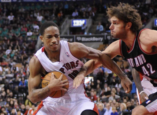 Nov 17, 2013; Toronto, Ontario, CAN; Toronto Raptors shooting guard DeMar DeRozan (10) drives the ball to the basket with Portland Trail Blazers center Robin Lopez (42) defending during the fourth quarter of a game at the Air Canada Centre. Portland won the game 118-110. Mandatory Credit: Mark Konezny-USA TODAY Sports