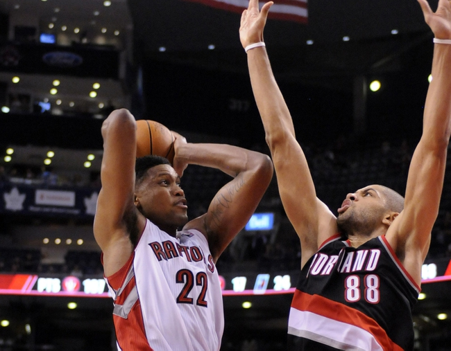 Nov 17, 2013; Toronto, Ontario, CAN;  Toronto Raptors small forward Rudy Gay (22) drives the ball to the basket with Portland Trail Blazers small forward Nicolas Batum (88) defending during the fourth quarter of a game at the Air Canada Centre. Portland won the game 118-110. Mandatory Credit: Mark Konezny-USA TODAY Sports