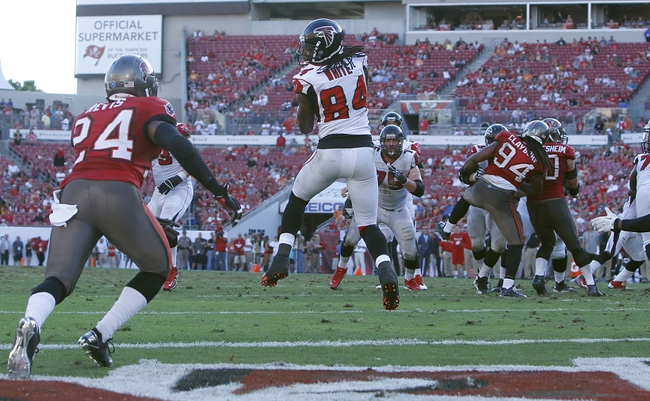 Nov 17, 2013; Tampa, FL, USA; Atlanta Falcons wide receiver Roddy White (84) catches the ball for a touchdown during the second half against the Tampa Bay Buccaneers at Raymond James Stadium. Tampa Bay Buccaneers defeated the Atlanta Falcons 41-28. Mandatory Credit: Kim Klement-USA TODAY Sports