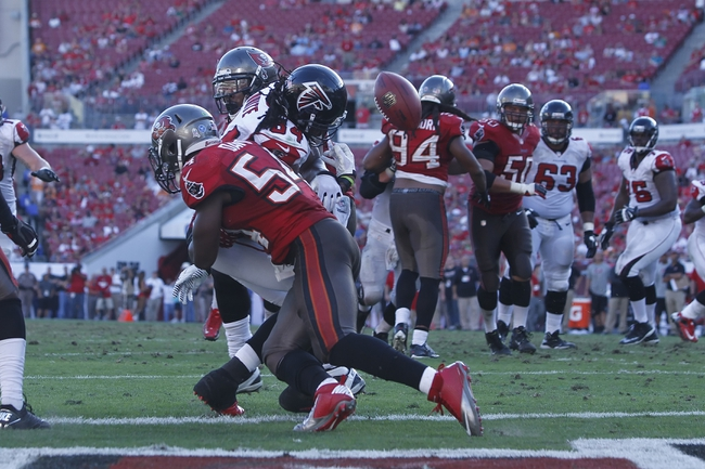 Nov 17, 2013; Tampa, FL, USA; Atlanta Falcons wide receiver Roddy White (84) looses the ball after he caught the ball for a touchdown during the second half against the Tampa Bay Buccaneers at Raymond James Stadium. Tampa Bay Buccaneers defeated the Atlanta Falcons 41-28. Mandatory Credit: Kim Klement-USA TODAY Sports