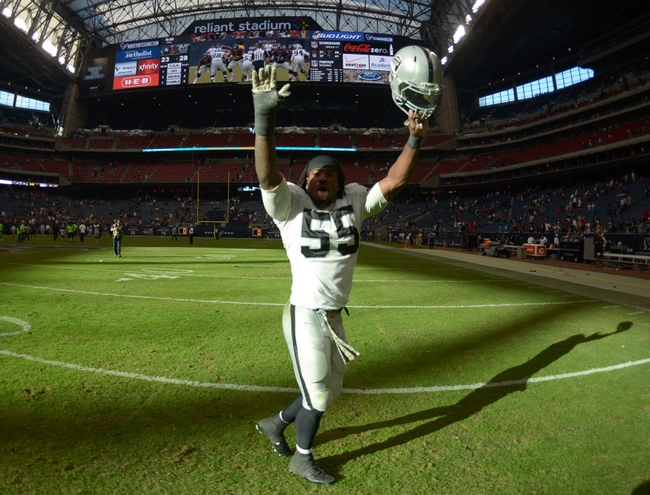 Nov 17, 2013; Houston, TX, USA; Oakland Raiders linebacker Sio Moore (55) celebrates at the end of the game against the Houston Texans at Reliant Stadium. The Raiders defeated the Texans 28-23. Mandatory Credit: Kirby Lee-USA TODAY Sports