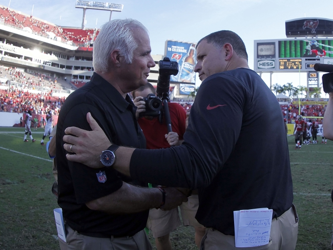 Nov 17, 2013; Tampa, FL, USA; Atlanta Falcons head coach Mike Smith and Tampa Bay Buccaneers head coach Greg Schiano shake hands at the end of the game at Raymond James Stadium. Tampa Bay Buccaneers defeated the Atlanta Falcons 41-28. Mandatory Credit: Kim Klement-USA TODAY Sports