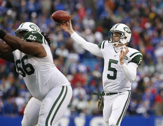 Nov 17, 2013; Orchard Park, NY, USA; New York Jets quarterback Matt Simms (5) passes for a touchdown as guard Willie Colon (66) blocks during the second half against the Buffalo Bills at Ralph Wilson Stadium. Bills beat the Jets 37-14. Mandatory Credit: Kevin Hoffman-USA TODAY Sports