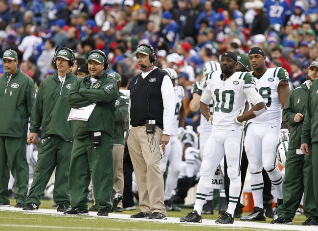 Nov 17, 2013; Orchard Park, NY, USA; New York Jets head coach Rex Ryan watches the games from the sideline during the second half against the Buffalo Bills at Ralph Wilson Stadium. Bills beat the Jets 37-14. Mandatory Credit: Kevin Hoffman-USA TODAY Sports
